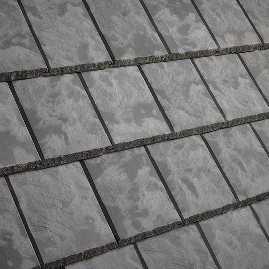 Roof Tiles: Textured Slate Roof Tiles on a House